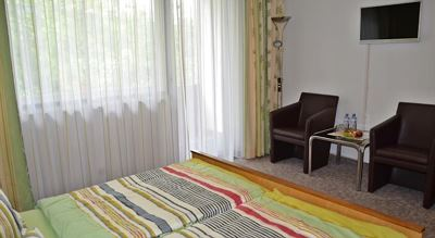 Double room, shower and bath, toilet, balcony